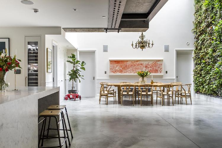 sunny and airy dining room with a living wall in London Clerkenwell Cooperage luxury apartment