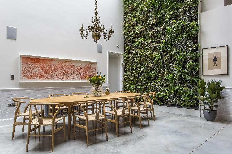 bright and breezy dining area with a living wall in London Clerkenwell Cooperage luxury apartment