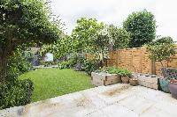 lush and lovely garden of London Mayfield Avenue II luxury apartment