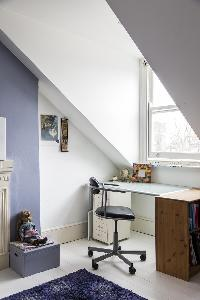cool desk by a window of London Mayfield Avenue II luxury apartment