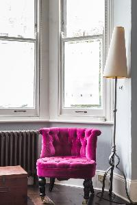 pretty pink accent chair in London Mayfield Avenue II luxury apartment