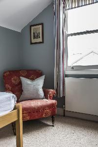 comfy armchair in London Mayfield Avenue II luxury apartment