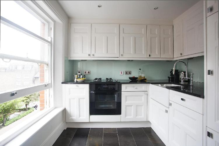 modern kitchen appliances and a generouswindow in London Brechin Place IV luxury apartment