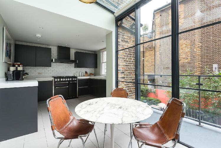 cool glass roof and walls of London St Quintin Avenue luxury apartment