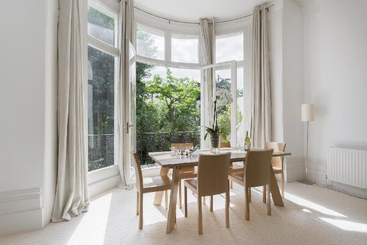 exquisite doors leading to the balcony of London Belsize Park IV luxury apartment