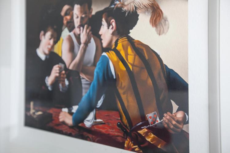 impressive print of The Cardsharps by Caravaggio on a wall of London Claremont Court luxury apartmen