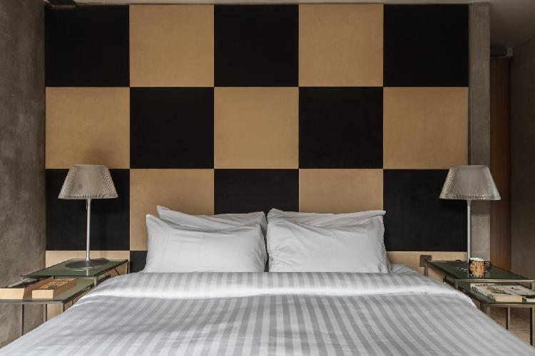 fine furnishings in checkerboard bedroom of London Clink Wharf luxury apartment