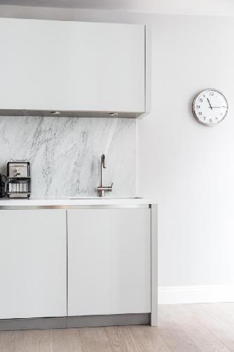 cool modern kitchen of London Rosary Gardens II luxury apartment