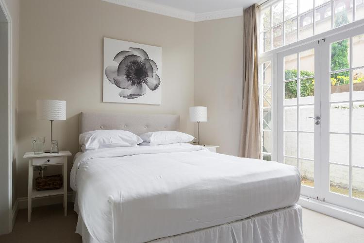 cool bedroom with balcony at London Rosary Gardens II luxury apartment