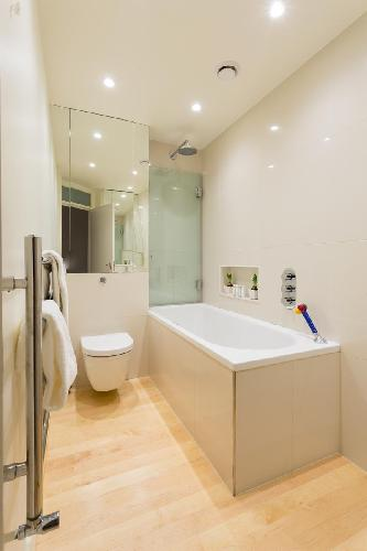 lovely bathroom with tub in London Sussex Gardens III luxury apartment