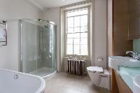 bathroom with tall window of luxury apartment in Abbey Gardens St John's Wood London
