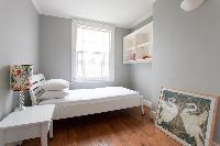 bright bedroom with wide windows of luxury apartment in Abbey Gardens St John's Wood London