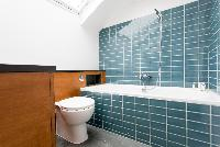 bathroom with a skylight above the tub in luxury apartment in Abbey Gardens St John's Wood London