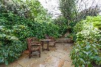 garden with plants and furnishings of luxury apartment in Abbey Gardens St John's Wood London