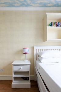 bedroom nightstand of luxury apartment in Abbey Gardens St John's Wood London