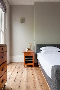 quaint wooden floorboards of a bedroom in luxury apartment in Abbey Gardens St John's Wood London