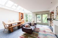 skylight and garden-bound glass doors dining room of luxury apartment in Abbey Gardens St John's Woo