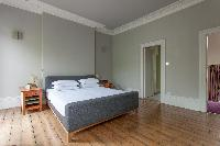 cozy bedroom with ensuite bath of luxury apartment in Abbey Gardens St John's Wood London