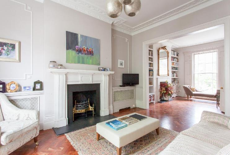 fireplace in the parlor of luxury apartment in Abbey Gardens St John's Wood London