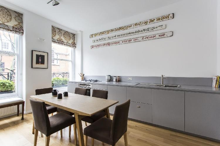 cool dining room and kitchen of London Handel Street luxury apartment