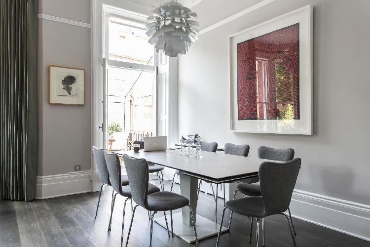 spacious, well-appointed dining room with doors to the patio of London Cresswell Gardens II luxury a