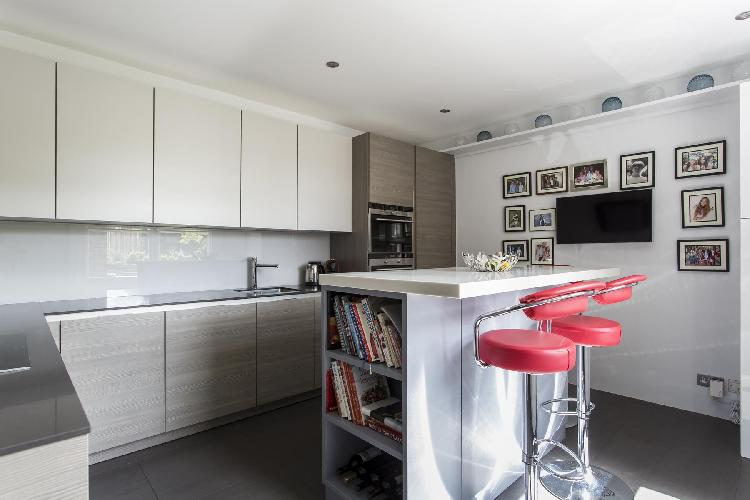 funky barstools at the island of the modern kitchen in London Cresswell Gardens II luxury apartment