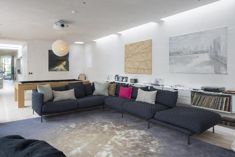 interesting well art against immaculate walls in the living room of London Blythe Road luxury apartm