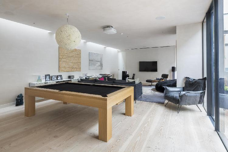 TV and game room of London Blythe Road luxury apartment
