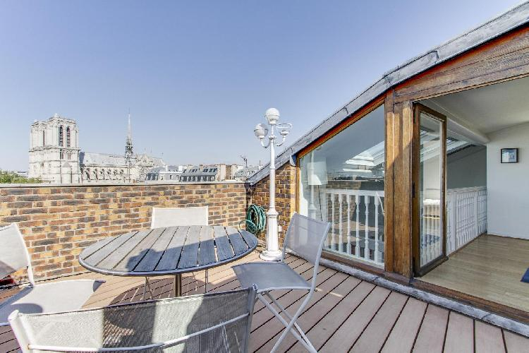 terrace with wonderful view of the Notre Dame de Paris in a Paris luxury apartment