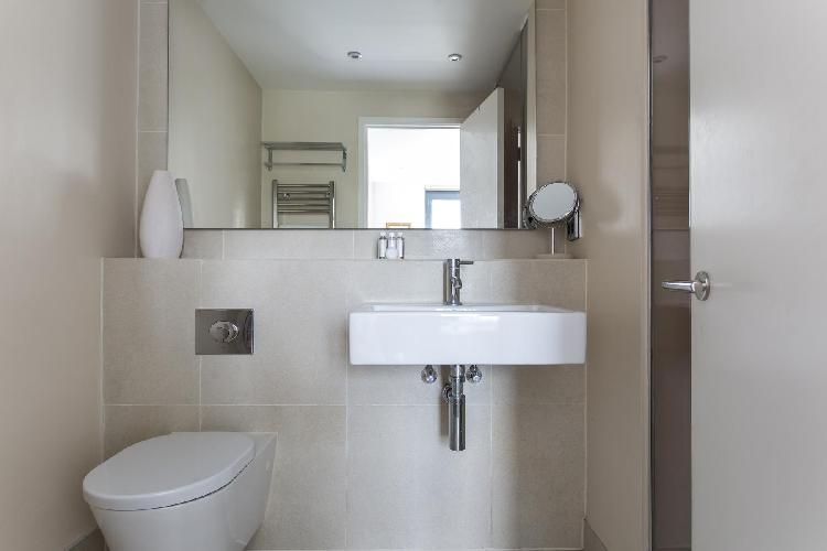 neat and fresh toilet and bath in London Tavistock Crescent luxury apartment