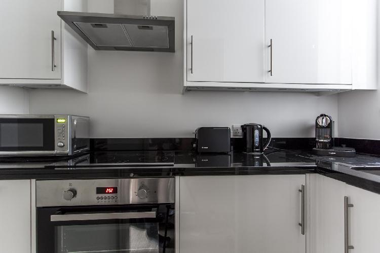 modern kitchen appliances and cabinets in London Drayton Gardens VIII luxury apartment