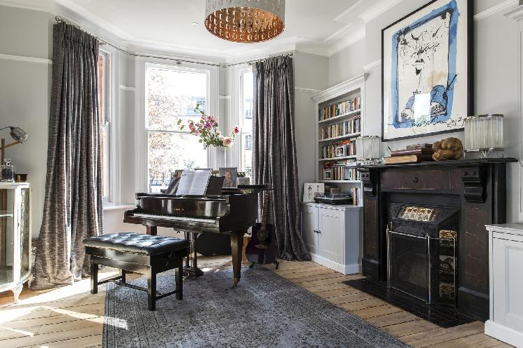 beautiful grand piano by the bay window of London Bramshill Gardens II luxury apartment