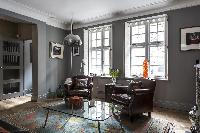 cool armchairs in the sitting area of London De Walden Street luxury apartment