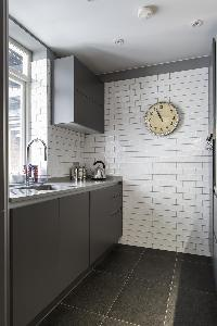 modern kitchen lighting and plumbing in London De Walden Street luxury apartment