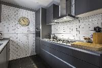 late-model appliances and glam cabinets in the kitchen of London De Walden Street luxury apartment