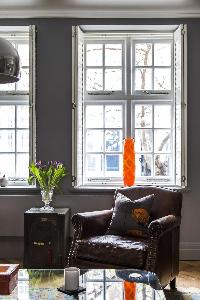 a comfy chair by a window in London De Walden Street luxury apartment