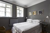 twin bedroom windows and nice wall art in London De Walden Street luxury apartment