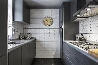 cool kitchen with modern appliances in London De Walden Street luxury apartment
