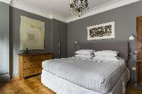 spacious, well-appointed bedroom of London De Walden Street luxury apartment