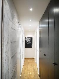 hallway with closet and work of art hanging on the wall  in paris luxury apartment