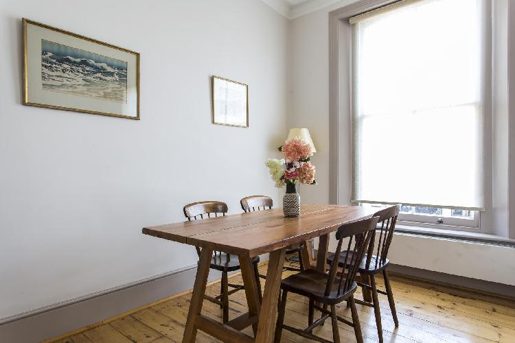 breezy and bright dining area of London Chalcot Road III luxury apartment