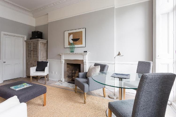 spacious, well-appointed dining room of London Cranley Place IV luxury apartment