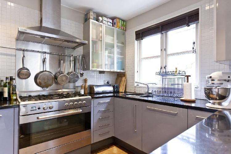 sunny and airy kitchen of London Chepstow Villas luxury apartment and holiday home