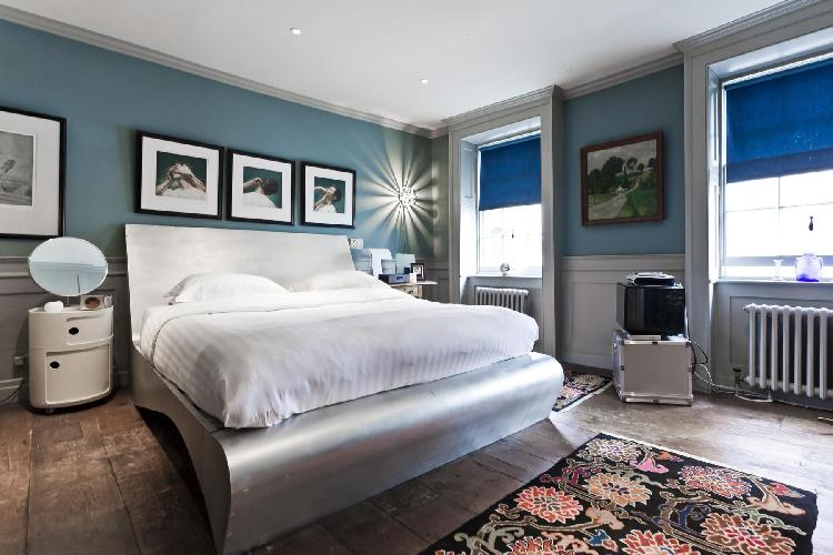 spacious, well-appointed bedroom of London Fournier Street luxury apartment