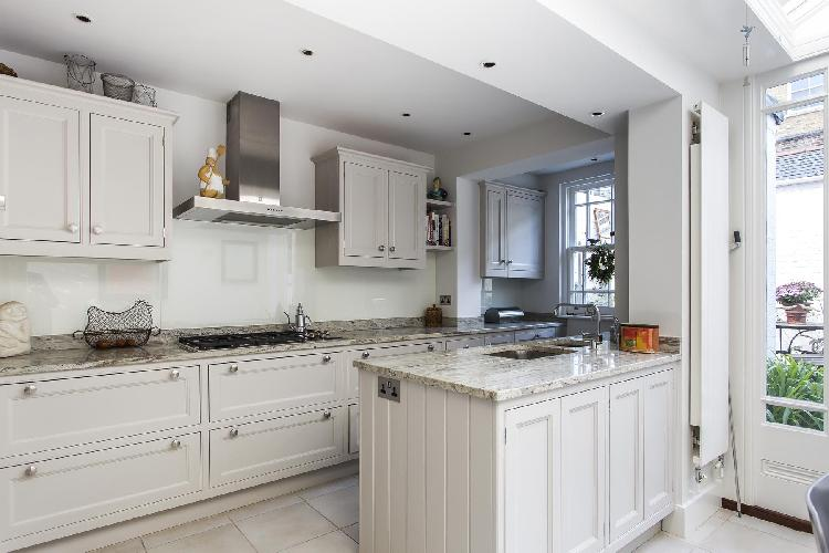 modern kitchen with marble-top counters in London Campden Street II luxury apartment