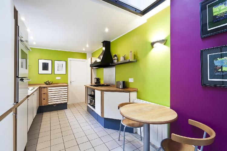 awesome aubergine and avocado walls of modern kitchen in London Cornwall Road luxury apartment