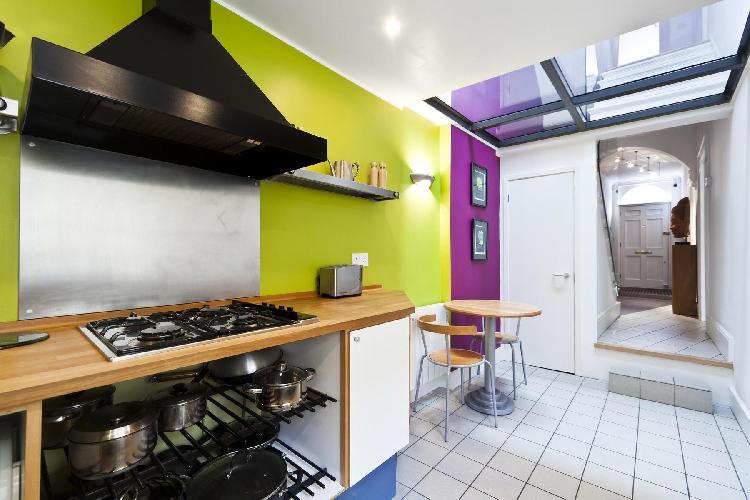 skylight-illuminated kitchen with modern appliances in London Cornwall Road luxury apartment