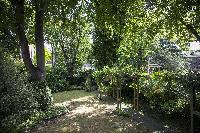 foliage-lined garden of London Alwyne Villas luxury apartment