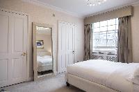 blushing bedroom walls of London Albert Terrace luxury apartment
