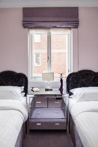 cool twin beds in London Albert Terrace luxury apartment